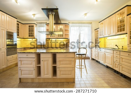 View of wooden cupboards in luxury kitchen - stock photo