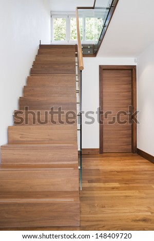 View of wooden staircase and floor in house