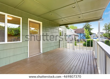 View of wooden walkout deck with white railings. Northwest, USA