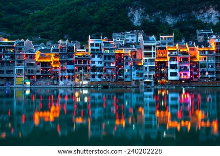 View of Wuyang River and Zhenyuan ancient town in twilight in China. Located on eastern part of Guizhou Province, Zhenyuan has long been an ancient town of the Miao people. - stock photo