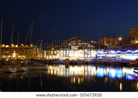 View of yachts and restaurants in the harbour at dusk, Benalmadena, Costa del Sol, Malaga Province, Andalucia, Spain, Western Europe. - stock photo