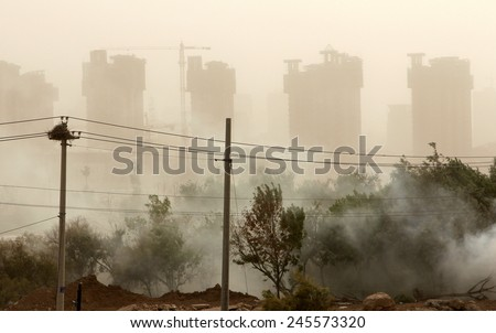 View of Yinchuan city (Ningxia province, China) during sand storm - stock photo