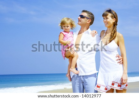 view of young family hanging out in summer environment