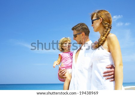 view of young family hanging out in summer environment.