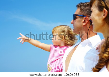 view of young family hanging out in summer environment. Focused on baby's face. - stock photo