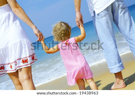 view of young family having fun on the beach