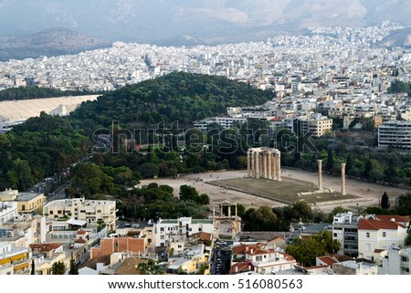 View on a city of Athens with archaeological ruins of the temple of Zeus, from the Acropolis in Athens, Greece