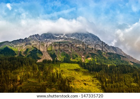 view on a cloudy mountain hill - stock photo