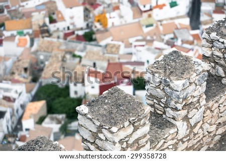 View on a mountain village from castle wall - stock photo