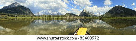 View on a panorama of mountain lake from a canoe (Vermillion Lakes. Banff National Park, Alberta, Canada)