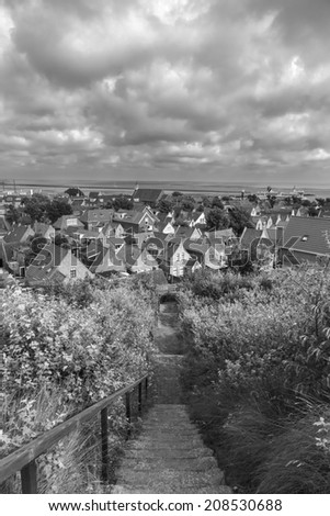 View on a small village on the island Terschelling in the Netherlands  (black and white) - stock photo