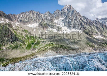 View on Argentiere glacier. Hiking to Argentiere glacier with the view on the massif des Aiguilles Rouges in French Alps - stock photo