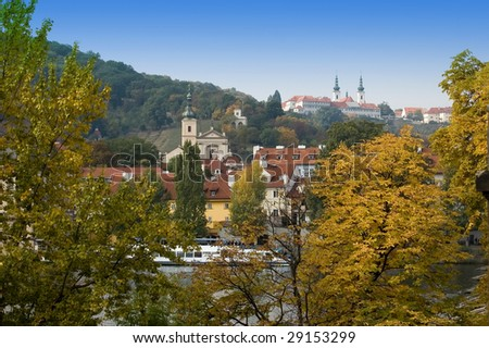 View  on autumn Prague through foliage
