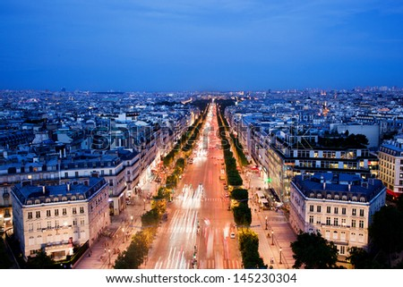 View on Avenue des Champs-Elysees from Arc de Triomphe at night Paris, France - stock photo