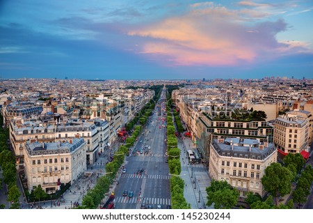 View on Avenue des Champs-Elysees from Arc de Triomphe at sunset, Paris, France - stock photo