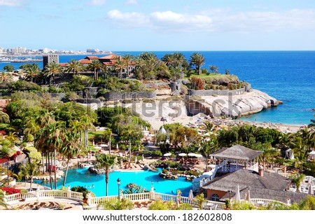 View on beach and swimming pool at the luxury hotel, Tenerife island, Spain - stock photo