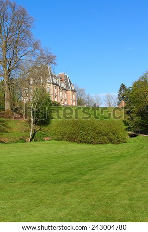 View on beautiful landscape with old mansion at Saint Saens, France