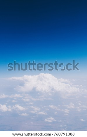 View on blue sky with clouds from high