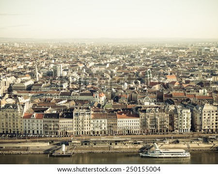 View on Budapest from Gellert Hill, Hungary. Houses, river Danube in the background of clear blue sky. Toned. - stock photo
