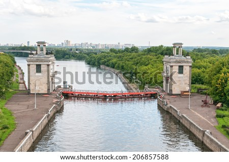 View on canal with closed shipping lock against skyline. Moscow, Russia.   - stock photo