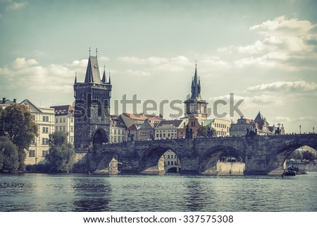 View on Charles Bridge in Prague, Czech Republic. Toned photo. - stock photo