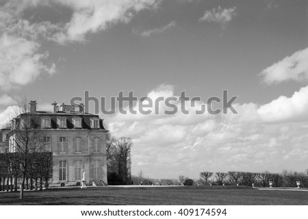 View on Chateau de Champs in Champs-sur-Marne (France). Aged photo. Black and white. - stock photo
