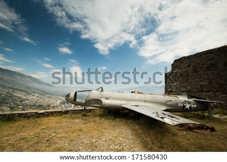 View on City of Gjirokastra located in Albanian with famous airplane located in fortress - stock photo