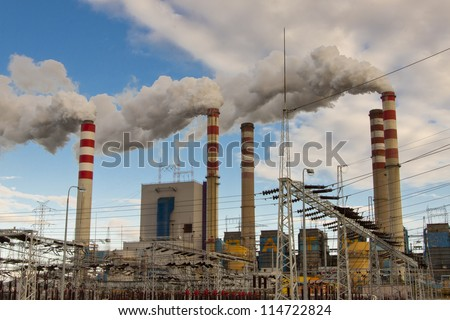 View on coal power station in Poland, Europe. Heavy industry. - stock photo