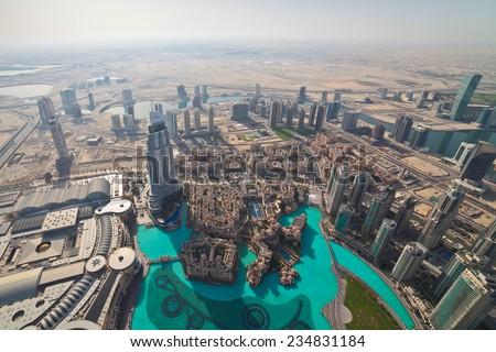 View on Downtown Dubai from Burj Khalifa at sunny morning, United Arab Emirates. - stock photo