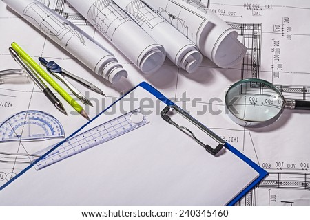 view on drawing tools with blueprints - stock photo