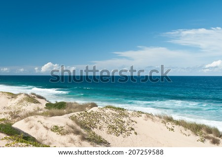 View on Dunes and Indian Ocean, Tofo, Mozambique - stock photo