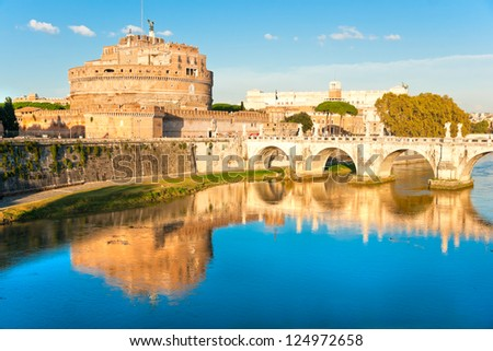 View on famous Saint Angel castle and bridge over the Tiber river in Rome, Italy. - stock photo