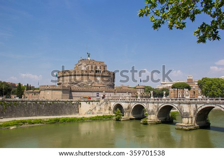 View on famous Saint Angel castle and bridge over the Tiber river in Rome, Italy - stock photo