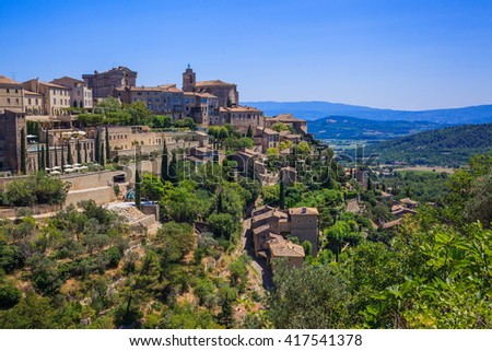 View on Gordes, a small typical town in Provence, France. Beautiful village, with view on roof and landscape - stock photo