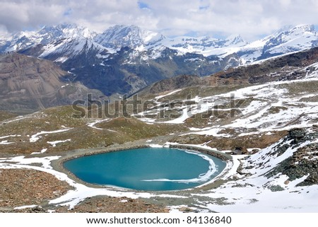 View on Gornergrat lake and mountain ridge, Switzerland - stock photo