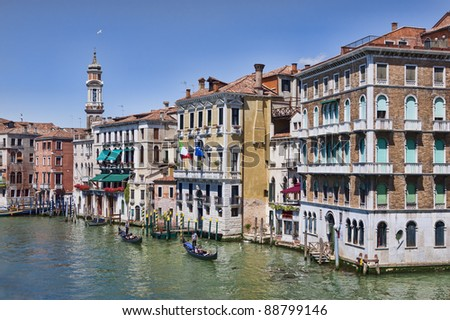 View on Grand Canal buildings and gondolas from the ancient Rialto bridge in Venice - stock photo