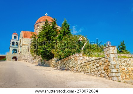 View on Greek typical church with classic red roofing, Greek Island Kalymnos, Greece - stock photo