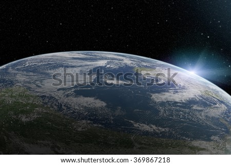 View on illuminated beautiful planet Earth from space and sunrise over cloudy ocean with stars in the sky. High resolution photo. Elements of this image furnished by NASA.