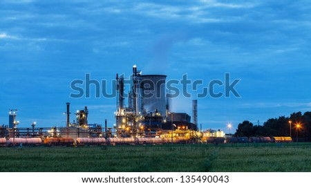 View on illuminated operational chemical plant in twilight