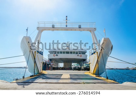 View on interior of empty ferry waiting in harbour to be loaded with cars in sunny summer day - stock photo