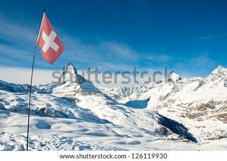 View on Matterhorn, swiss flag and Riffelberg ski station - stock photo