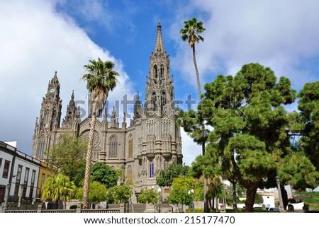 View on Medieval beautiful parish church of San Juan Bautista - impressive Gothic Cathedral in Arucas, Gran Canaria, Spain. - stock photo