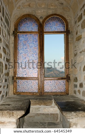 View on mountain through stained glass window - stock photo