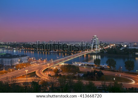 View on New bridge over Danube river from castle hill in Bratislava,Slovakia at twilight - stock photo
