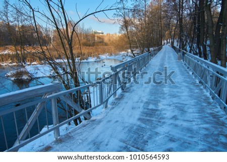 View on new wooden walkway and bridge on the Yauza river in winter, Babushkinskiy district in Moscow
