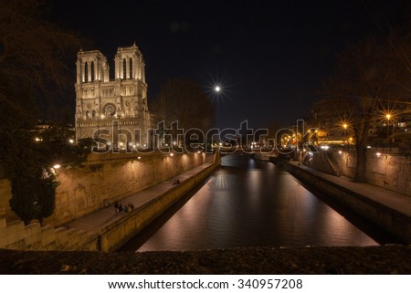 view on notre dame de paris at night - stock photo