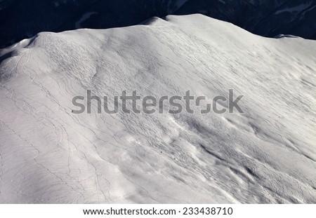 View on off-piste slope at sunny evening. Caucasus Mountains, Georgia, ski resort  - stock photo