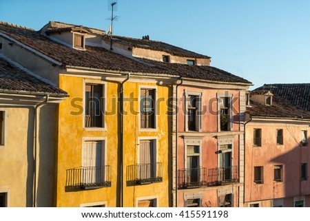 View on painted houses with tiled roofs in sunlight