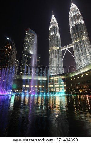View on Petronas Twin Towers fountain in Kuala Lumpur at night - stock photo