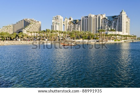 View on promenade of the northern beach of Eilat - famous resort and recreation city of Israel - stock photo